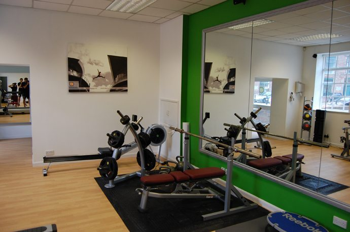 Using mirrors effectively in gym design motive